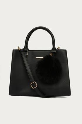 BLACK GIANT POM HANDHELD BAG