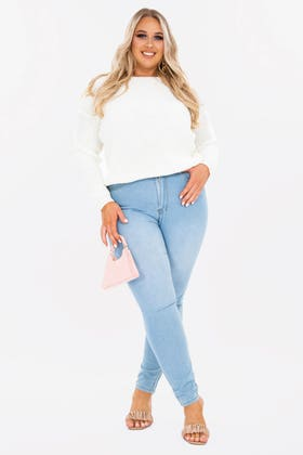 LIGHT BLUE PLUS HIGHWAISTED JEANS WITH DISTRESS ON BACK POCKET